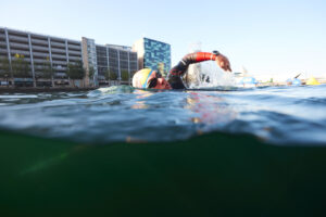 Image of a swimmer in The Quays. It's near Amplify, which has Salford Quays apartments for sale.