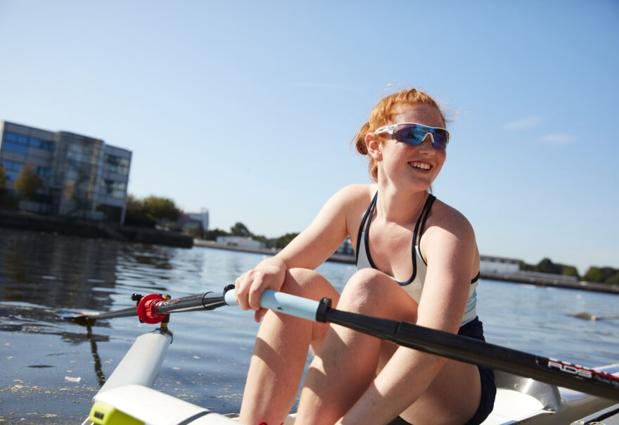 Image of a female rower in the River Irwell. It's near Amplify, which has Salford Quays apartments for sale.