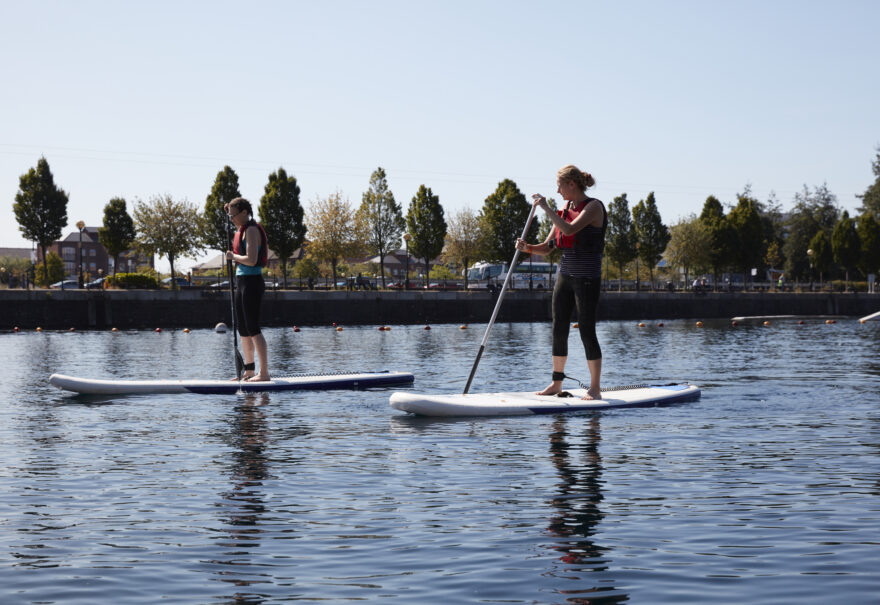 Image of a female paddleboarders. It's near Amplify, which has Salford Quays apartments for sale.